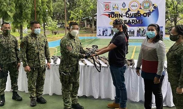 Former Rebels Turn Firearms Over to Police in Bukidnon